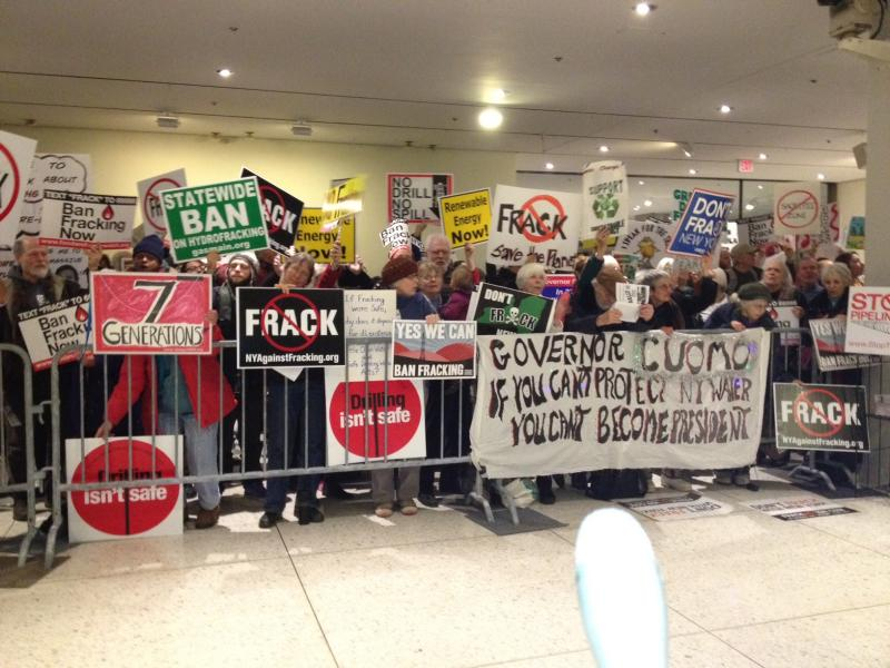 Protesters of hydrofracking display signs at Gov. Andrew Cuomo's State of the State address Wednesday.