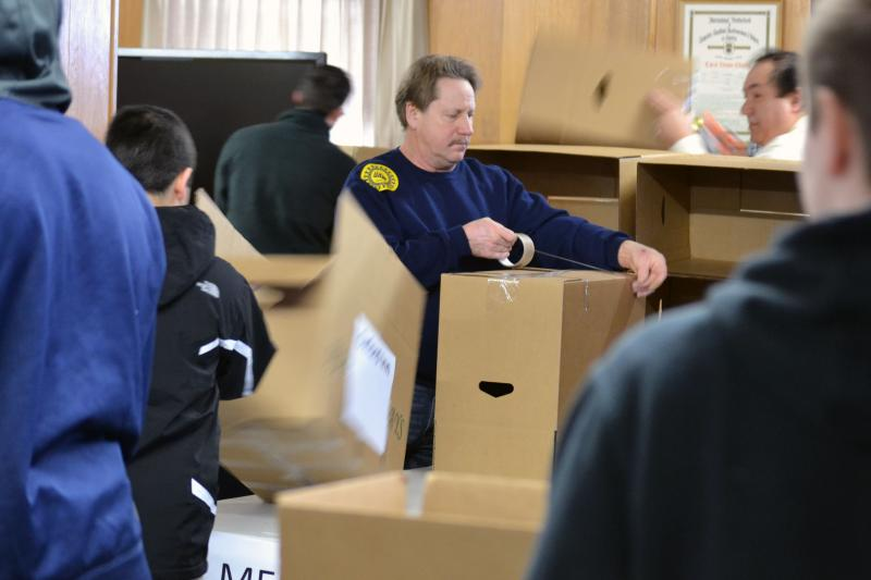 Volunteers at a Martin Luther King Jr. Day food and clothing drive in Syracuse.