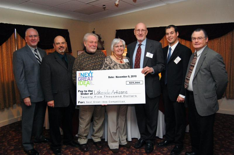"Lakeside Artisans accepts their award during the 2010 ""Next Great Idea"" competition.  From left to right: Jeff Grimshaw, Larry Perras, Allen Bjorkman, Michele Southgate, Tim Ames, Austin Wheelock, and L. Michael Treadwell."