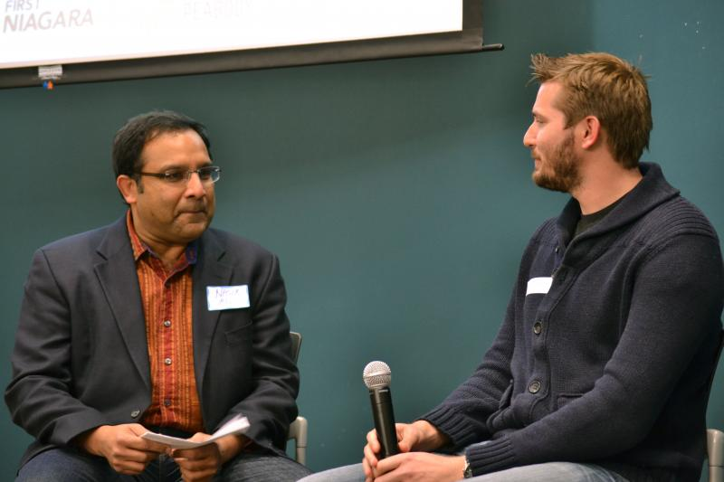 Nasir Ali, left, and Clint Nelson discuss the startup scene in Syracuse at the launch of Startup Labs.