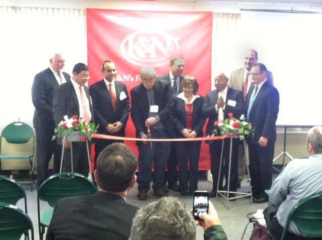 Fulton Mayor Ron Woodward cuts the ribbon at K&N's Foods inauguration Friday.