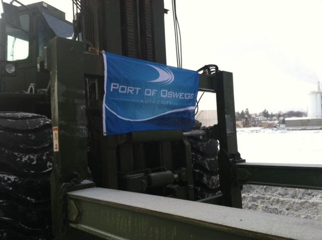 The Port of Oswego has received a new container reach stacker, which will keep the port from having to rent a crane.