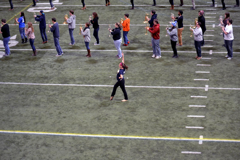 The Syracuse University Marching Band rehearses for the Super Bowl XLVIII pregame show Sunday.