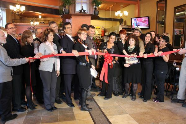 The Greater Utica Chamber of Commerce attends a ribbon cutting ceremony for Bella Regina in downtown Utica.