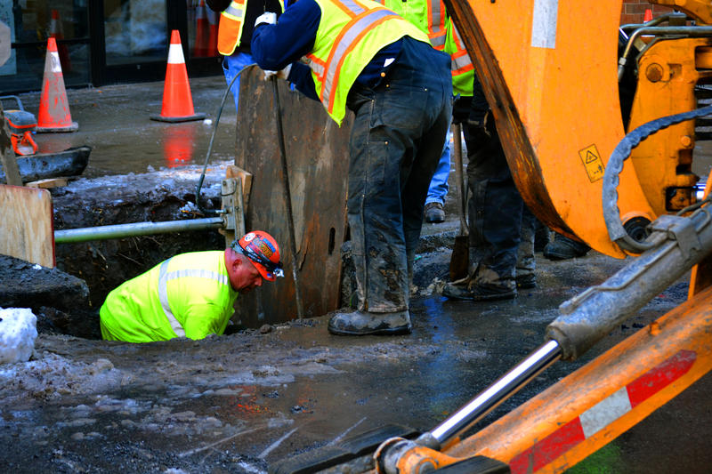 Crews work to repair a water main break on East Fayette Street in Syracuse.