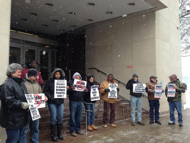 Protestors rally against Gov. Andrew Cuomo's budget plan in front of the state office building in Syracuse.