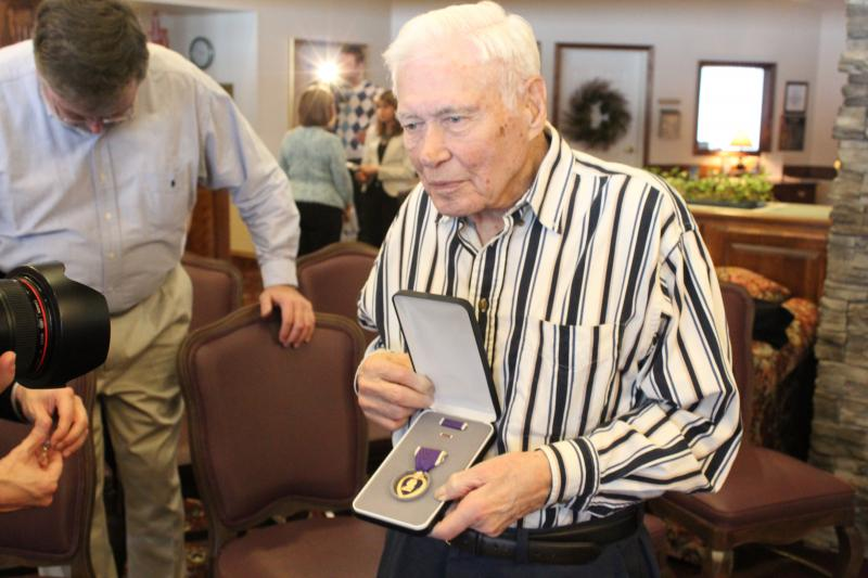 Faulkner poses with his Purple Heart.
