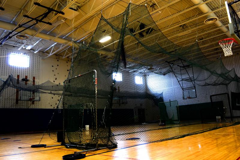 The batting cages at Cicero-North Syracuse high school have been well used this spring since the team can't practice outdoors.