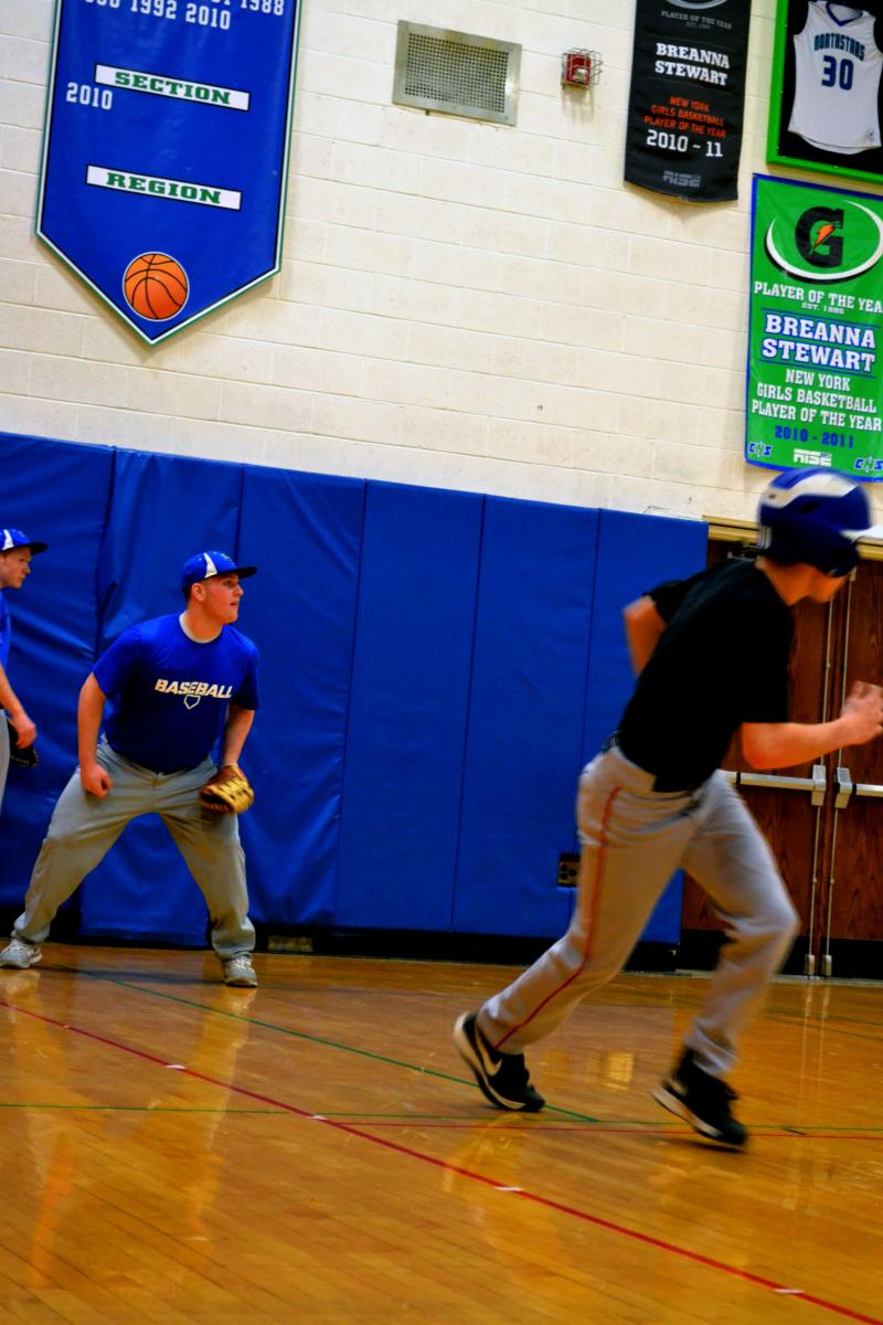 Cicero-North Syracuse baseball practice inside the high school gynasium.