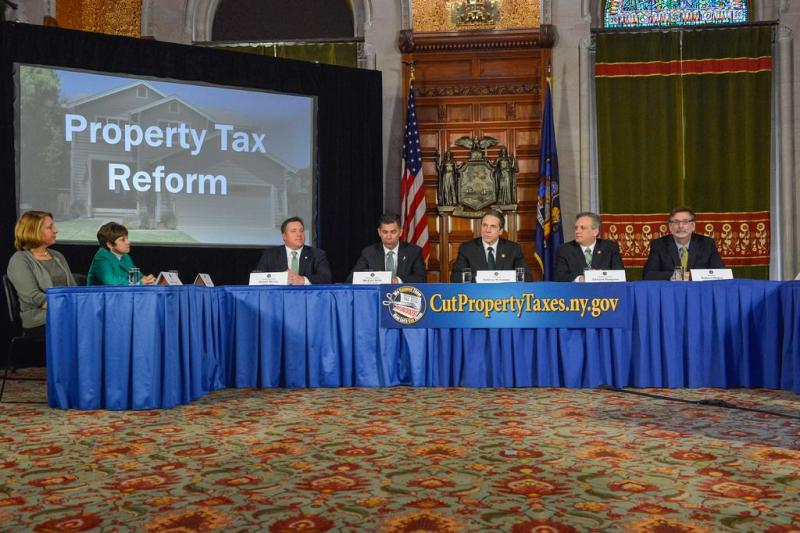 Gov. Andrew Cuomo brought local leaders from both parties to the Capitol to promoted his property tax plan.