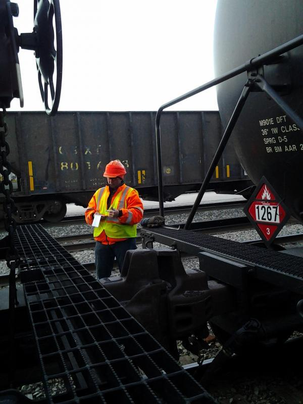 New York State Department of Transportation (NYSDOT) worker at a rail yard inspection.