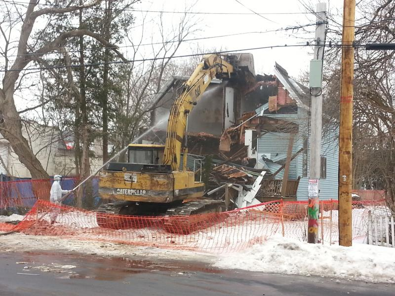 The Syracuse Land Bank demolished it's first vacant home Monday.