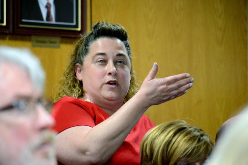 Kelly Abt, a parent of a Fowler High School student, asks a question at a school board meeting.