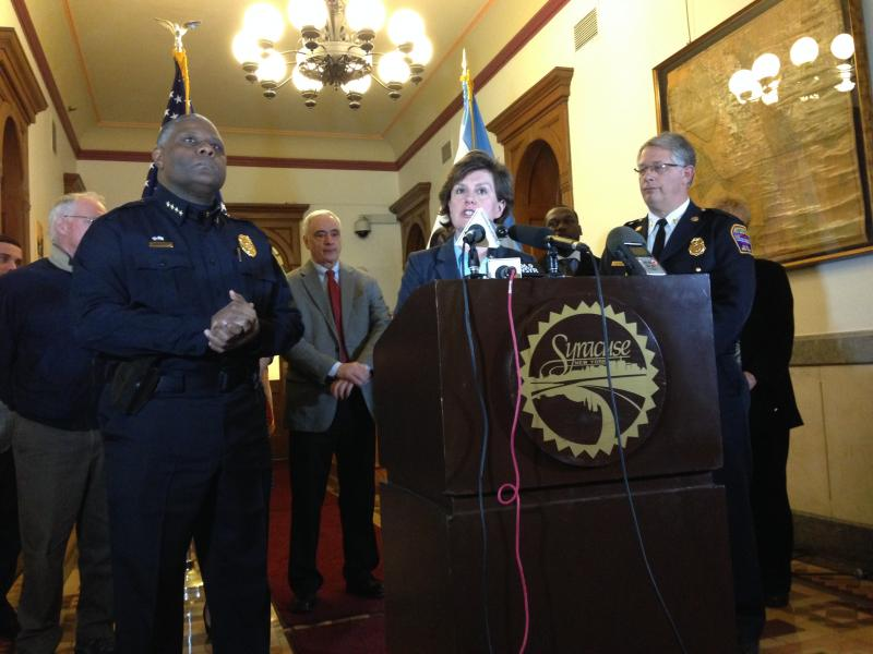 Mayor Stephanie Miner flanked by the police and fire chiefs and some members of Common Council as she announces her proposal to include a new class of police and firefighters in the fiscal year 2014-15 budget Monday.