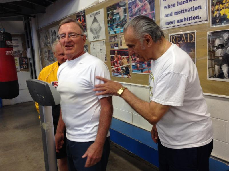 """Sugar"" Ray Rinaldi (right) has some fun with John ""The Pit Bull"" Francisco during the senator's weigh-in."