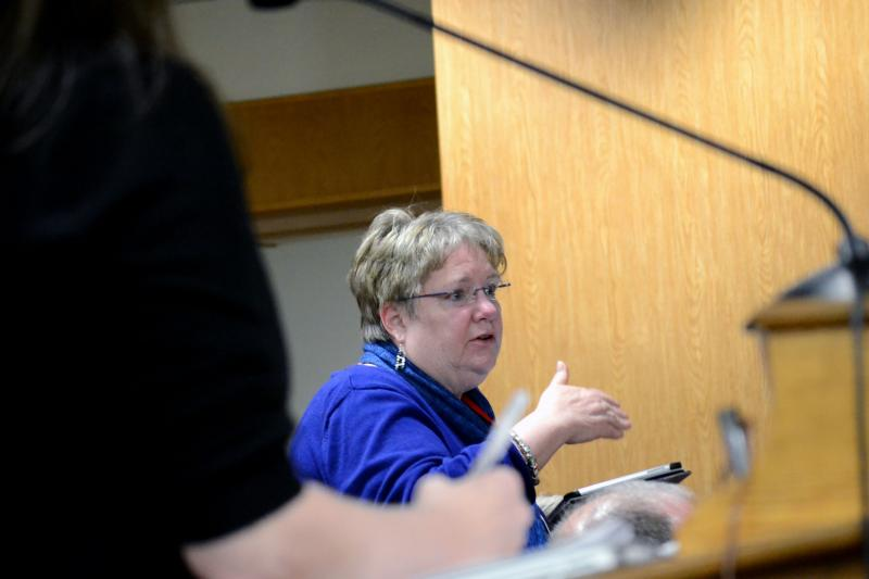 Christine Fiske, a nurse in the Syracuse school district, speaks at a board meeting.