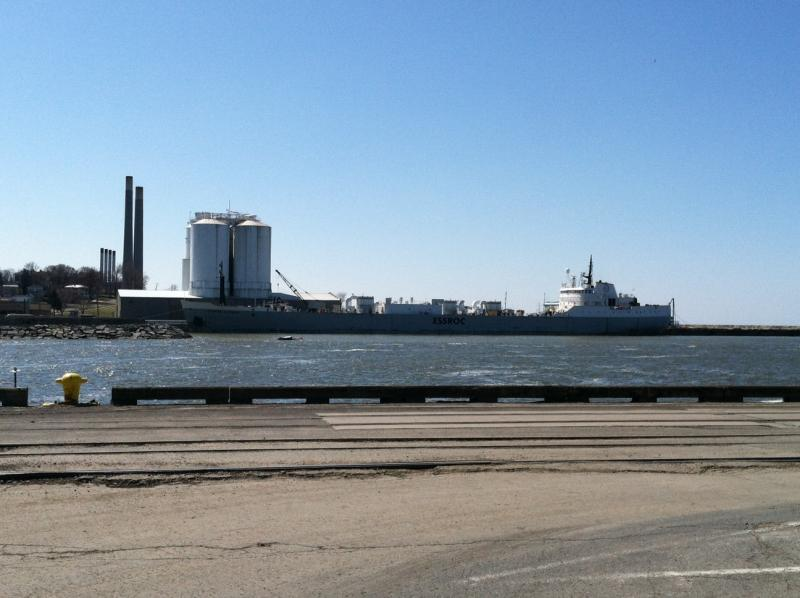A ship docks near the Port of Oswego office.