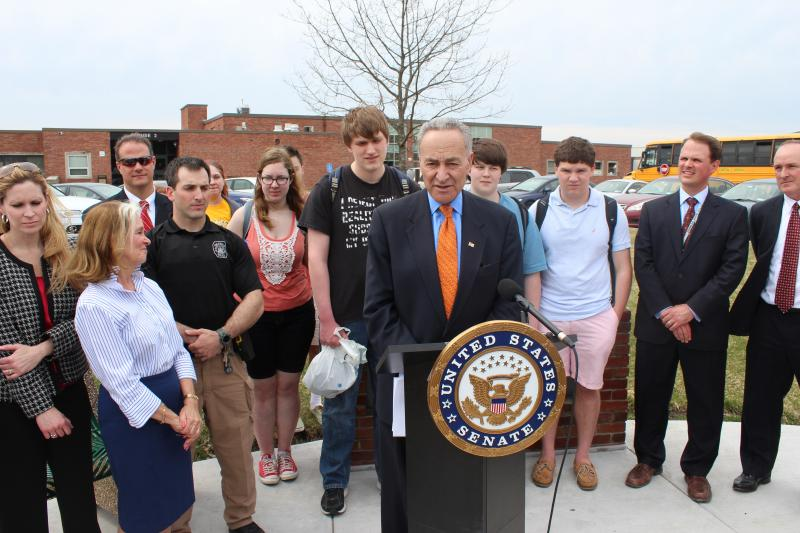 Sen. Chuck Schumer (D-NY) stands in front of Fayetteville-Manlius High School to discuss school safety.