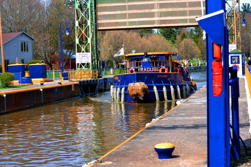 The Tug Boat Syracuse, part of the Canal Corp's fleet, pulls into Lock 24 in Baldwinsville Wednesday, the first day of the canal season.