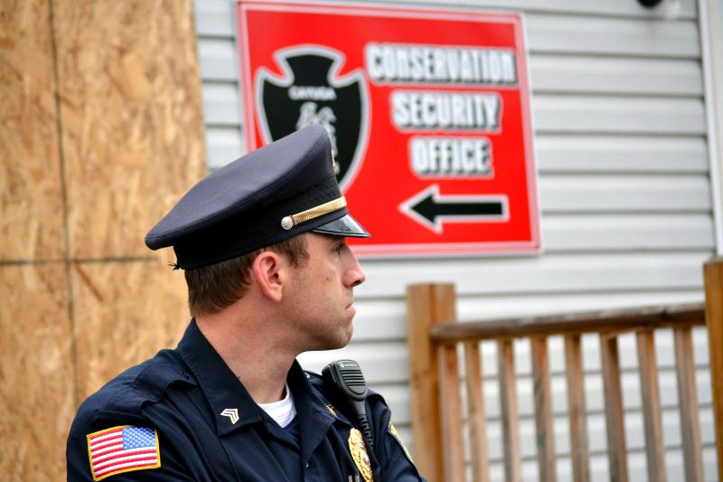 A police officer guards a Cayuga Nation office in Seneca Falls earlier this month.