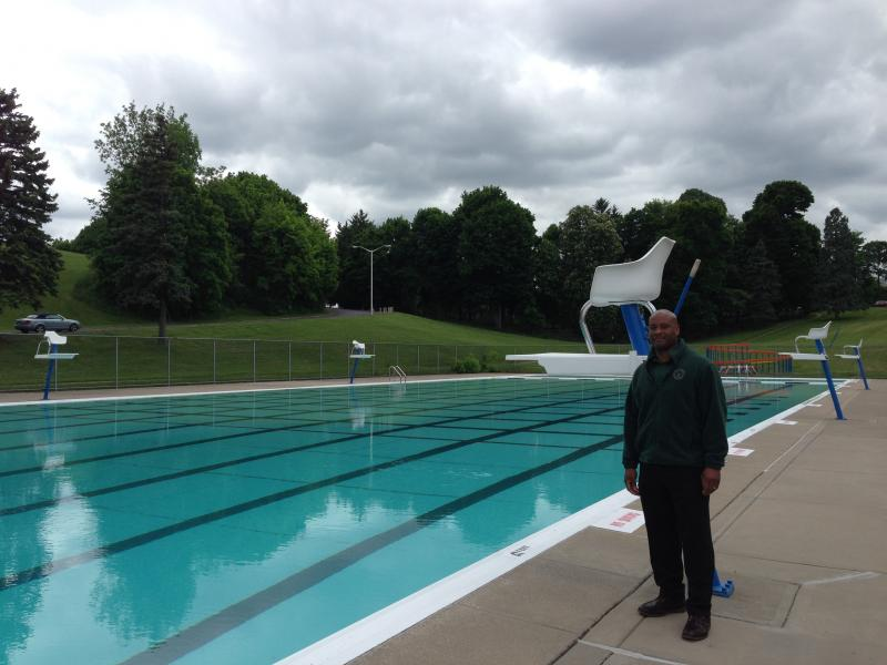 Syracuse Parks commissioner Baye Muhammad stands next ot the Thorndon Park pool, one of eight in the city.