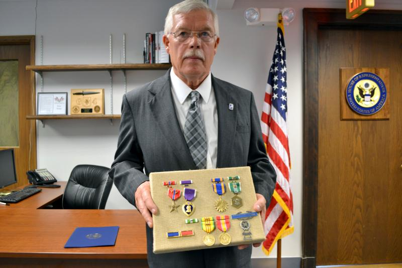 Retired Army Sgt. Lauren Dates with the medals he earned during his service in Vietnam.