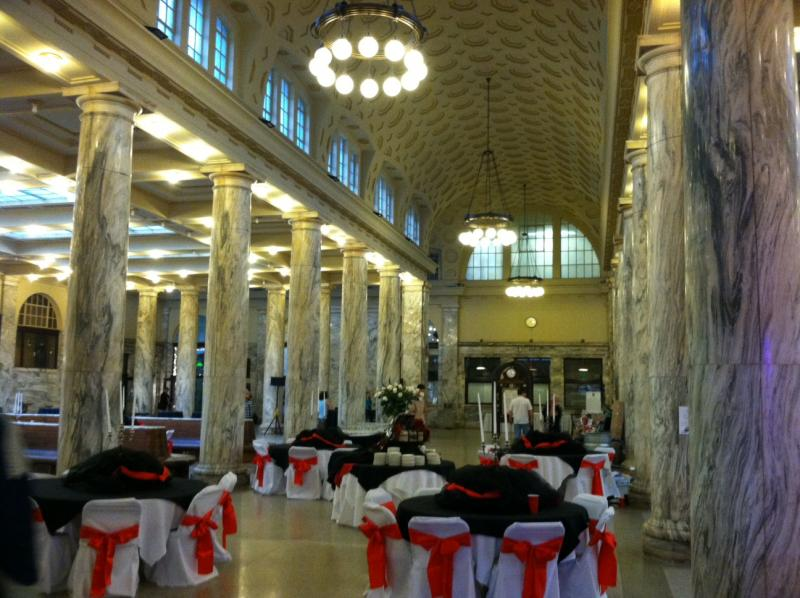 Decorated tables for a dance fill the main concourse of Utica's Union Station.