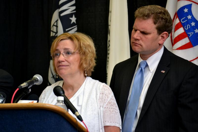 Alice Hackett, left, with Rep. Dan Maffei discussing Hackett's late husband, Larry, who died of a cancer likely caused by exposure to Agent Orange during the Vietnam War.