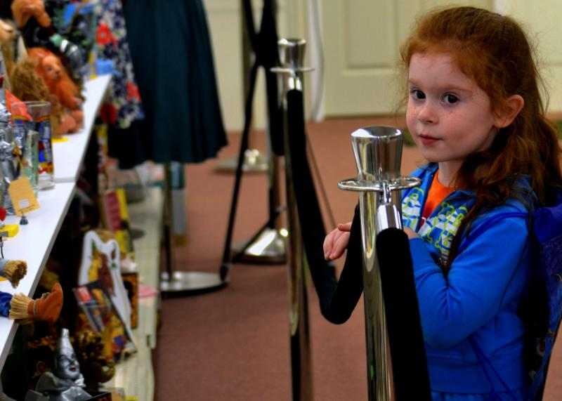 Chloe Laufer inspects Wizard of Oz memorabilia at the All Things Oz Museum in Chittenango.
