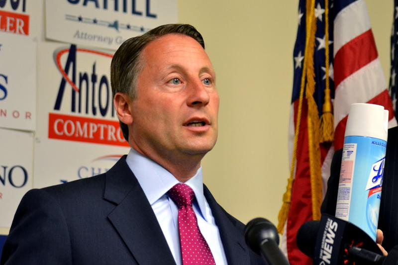 Rob Astorino, the Republican nominee for governor, holds a can of Lysol, saying Albany needs to disinfected.