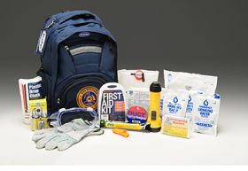 An emergency backpack, along with some of the supplies needed in the case of an emergency.