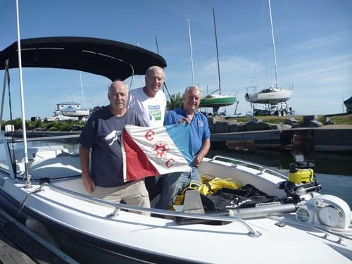 Exploreers Roland Stevens, Jim Kennard and Roger Pawlowski, the divers who found the sunken plane.