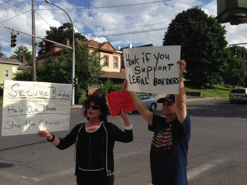 Some central New Yorkers, including Maria Thomas of Syracuse (at left), are protesting the possibility of housing Central American immigrant children in Syracuse