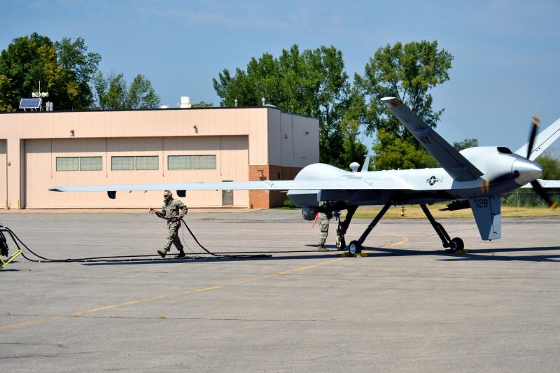 Air National Guard members prepare an MQ-9 Reaper drone for a taxi demonstation at Hancock Airfield in Syracuse.