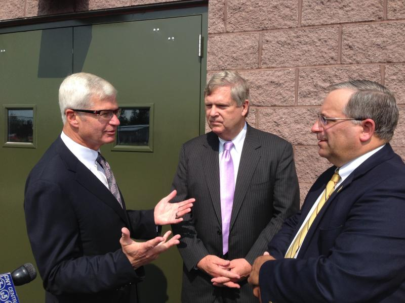 United States Agriculture Secretary Tom Vilsack (middle) discusses the Rural Infrastructure Opportuntity Fund during a recent visit to Madison County.
