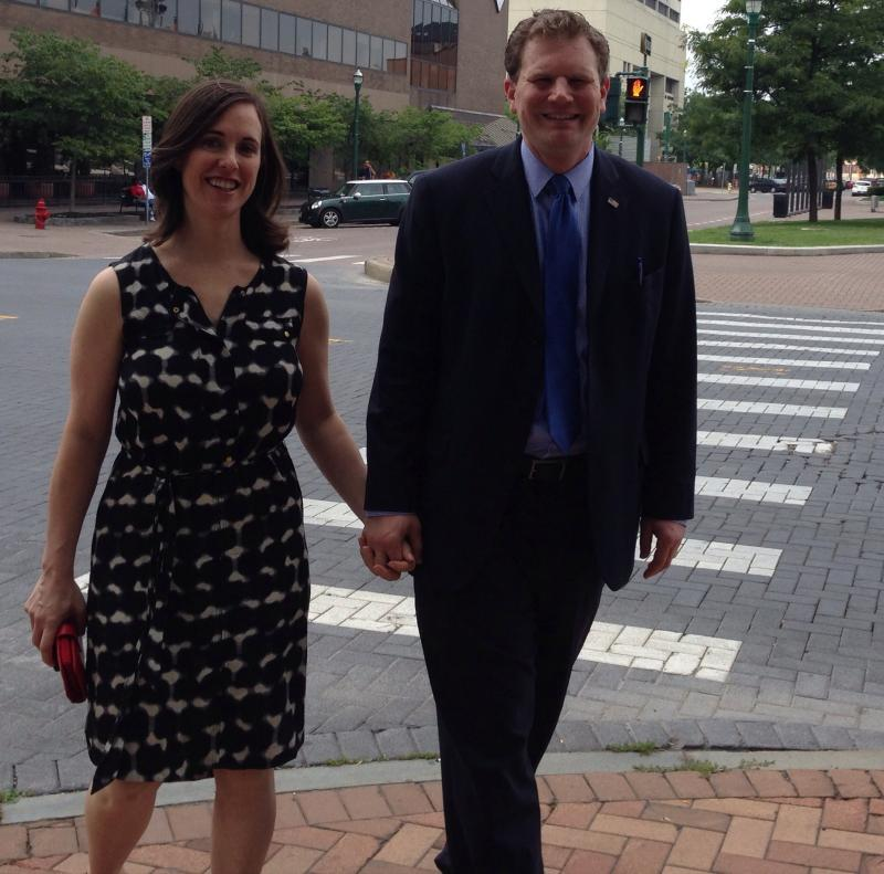 Dan Maffei and his wife, Abby, hold hands while walking to where Maffei held his press conference Wednesday.