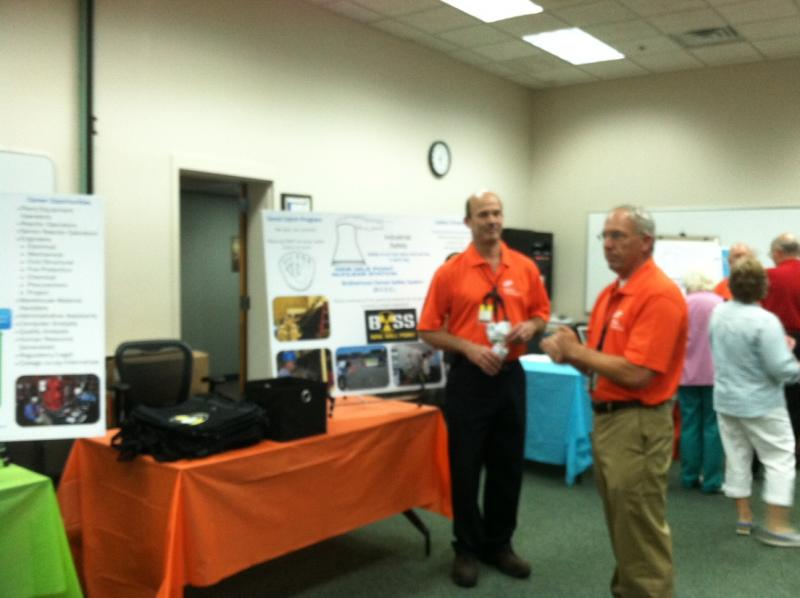 Exelon employees talk during Nine Mile Point's open house. Employees created displays ranging from human resources to the plant's industrial fire brigade.