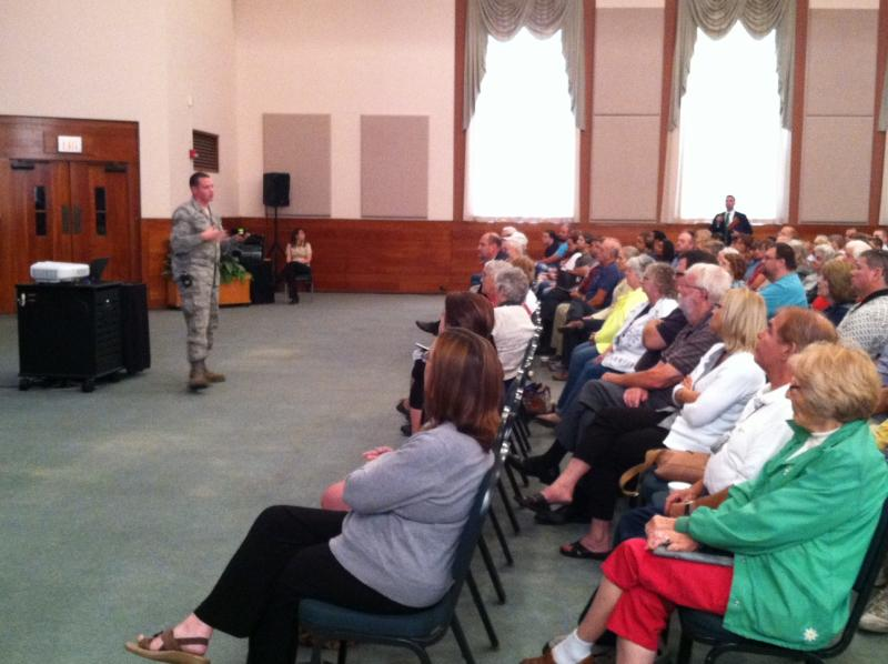 A member of the New York National Guard speaks to a large crowd at SUNY Oswego.