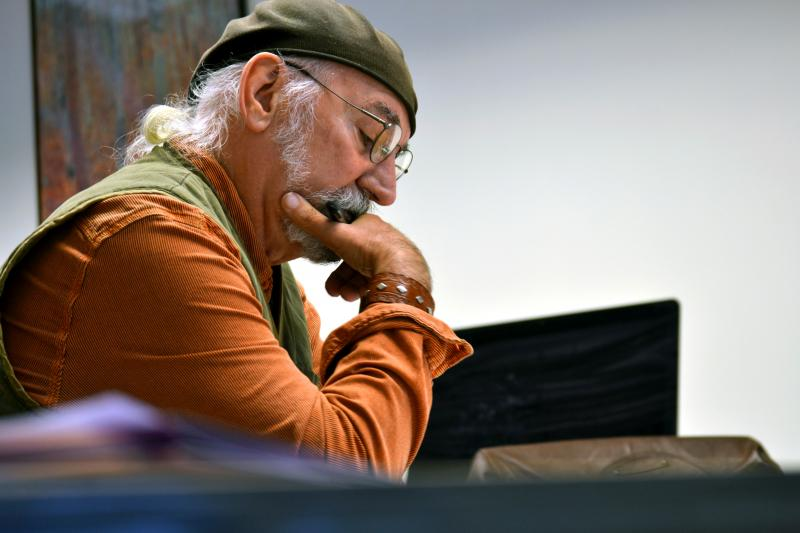 Doug D'elia, who served in the Air Force in Vietnam, reads a writing prompt at a veterans writing group.