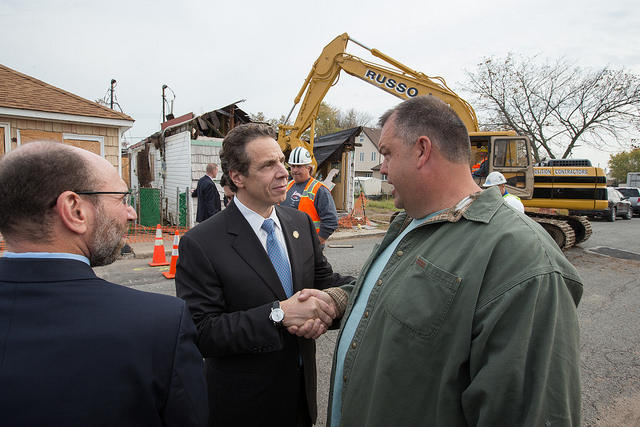 Gov. Andrew Cuomo meets with residents on Staten Island while on a tour highlighting the Superstorm Sandy recovery effort. (file photo)