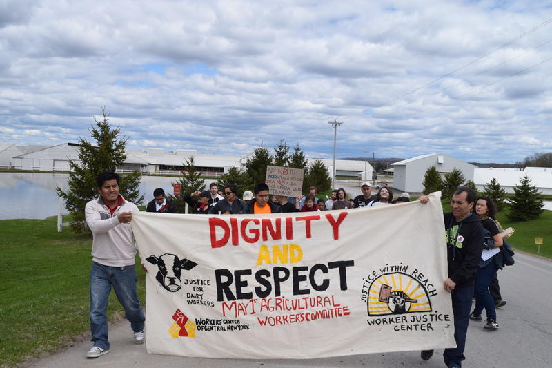 About 40 farm workers and advocates marched to the front gates of Marks Farms, south of Lowville, N.Y., to protest alleged worker abuses.