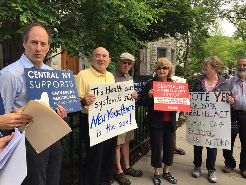 Activists celebrating the passage of the New York Health Act in downtown Syracuse.