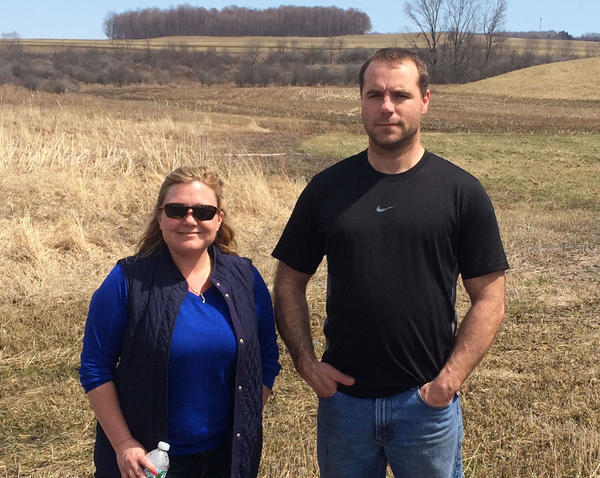 Heather and Tim Gowe stands on potential manure lagoon site