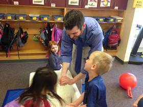 Canton Elementary School principal Joe McDonough plays with silly sand in the pre-K classroom.