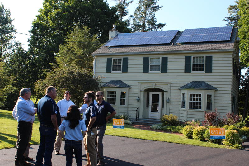 Solar energy installers talk at a Solarize CNY event at Sue Hansen's house in Fayetteville.