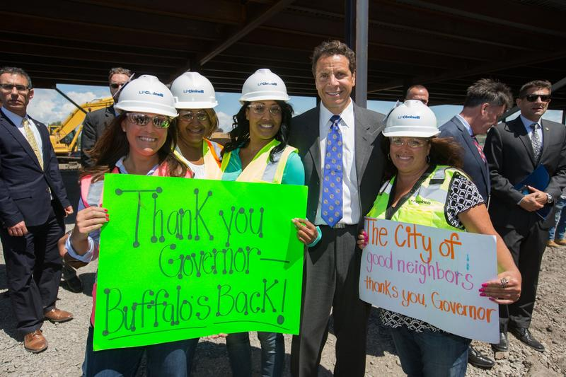 "Gov. Andrew Cuomo celebrates ""topping off"" of SolarCity gigafactory in Buffalo Aug. 4."