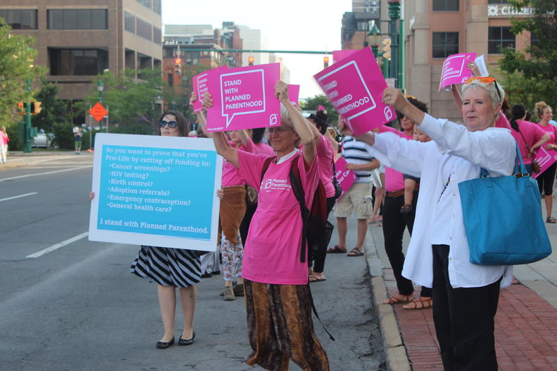 Protesters in downtown Syracuse don't want Congress to cut Planned Parenthood funding.