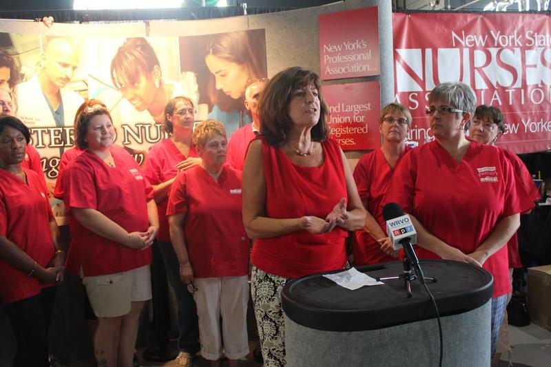 Judy Sheridan-Gonzalez (center), president of the New York State Nurses Association.