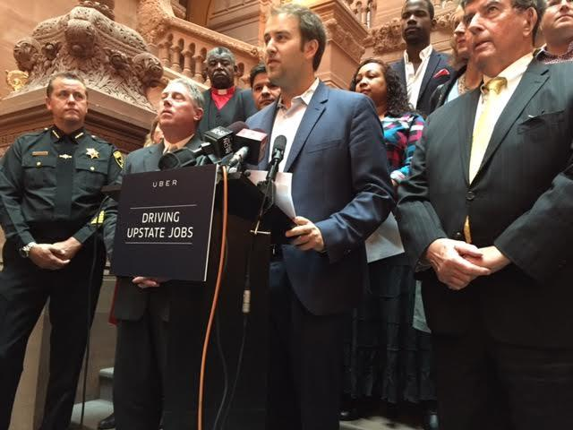 Josh Mohrer, general manager of Uber, surrounded by state lawmakers and other supporters in 2015, unsuccessfully advocated for the ride sharing service beyond New York City.
