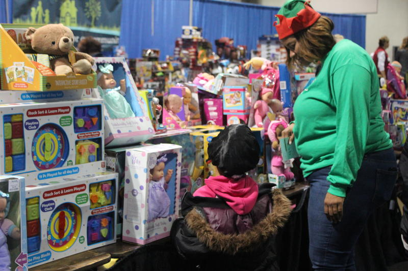Shopping for toys at the Christmas Bureau distribution.